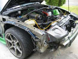 brokeas240sx s battery relocation writeup slip wire through stock harness hole